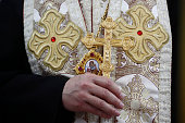 Bishop with cross during the religious ceremony