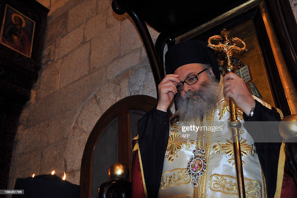 Bishop Yuhanna Yazigi crosses himself at his inauguration ceremony at the Balamand Monastery, north of Beirut, after he was elected as the new Patriarch of the Greek Orthodox church in Syria on December 17, 2012. AFP PHOTO / IBRAHIM CHALHOUB