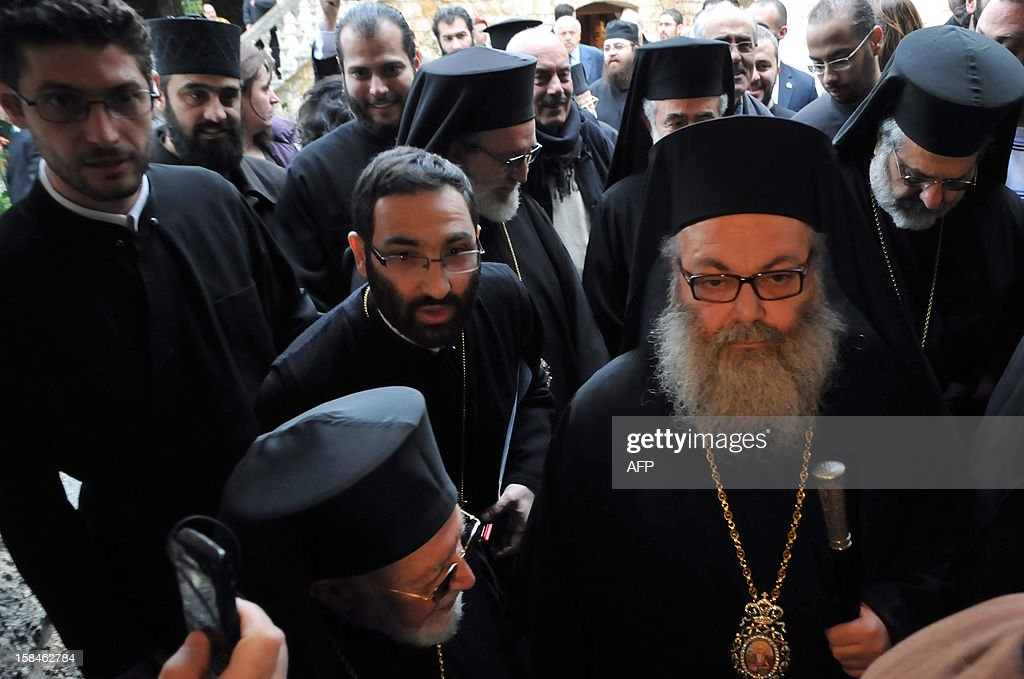 Bishop Yuhanna Yazigi (R) enters the Balamand Monastery, north of Beirut, for his inauguration ceremony on December 17, 2012, after he was elected as the new Patriarch of the Greek Orthodox church in Syria.
