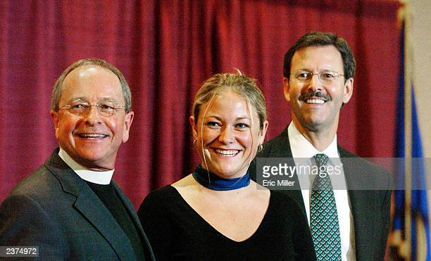 Bishopelect the Rev V Gene Robinson along with his daughter Ella and partner Mark Andrew attend a news conference after Robinson was confirmed as...