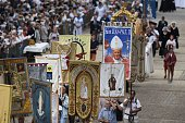Bishops and faithful hold flags depicting Saints and Pope John Paul II during the 'Grand Pardon' religious procession on July 26 2016 in...