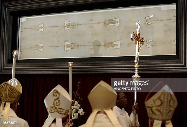 Bishops stand in front of the Shroud of Turin at the end of a mass celebrated by Turin Cardinal Severino Poletto to mark the first day of the display...