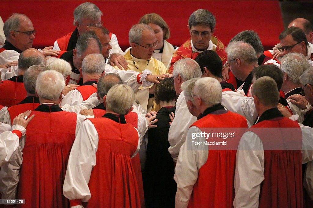 Bishops take part in the ceremonial laying on of hands as the Archbishop of Canterbury Justin Welby presides over the consecration of Rachel Treweek...