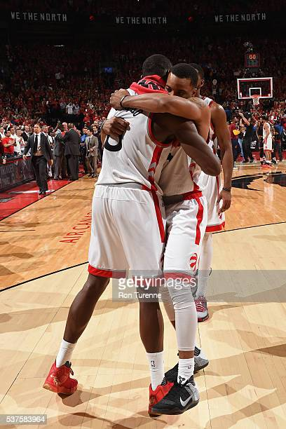 Bismack Biyombo and Kyle Lowry of the Toronto Raptors hug after Game Six of the NBA Eastern Conference Finals against the Cleveland Cavaliers at Air...