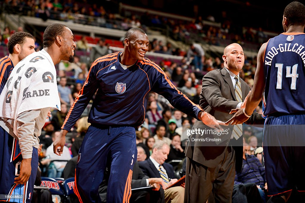 Bismack Biyombo #0 and Michael Kidd-Gilchrist #14 of the Charlotte Bobcats celebrate while playing against the Detroit Pistons on January 6, 2013 at The Palace of Auburn Hills in Auburn Hills, Michigan.