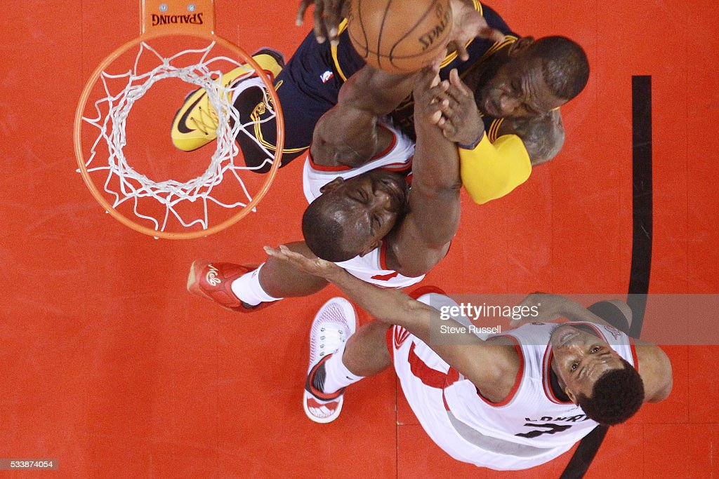 Bismack Biyombo blocks LeBron James and is called for the foul as Kyle Lowry looks on as the Toronto Raptors beat the Cleveland Cavaliers in game 4 of the NBA Conference Finals in Toronto. May 23, 2016.