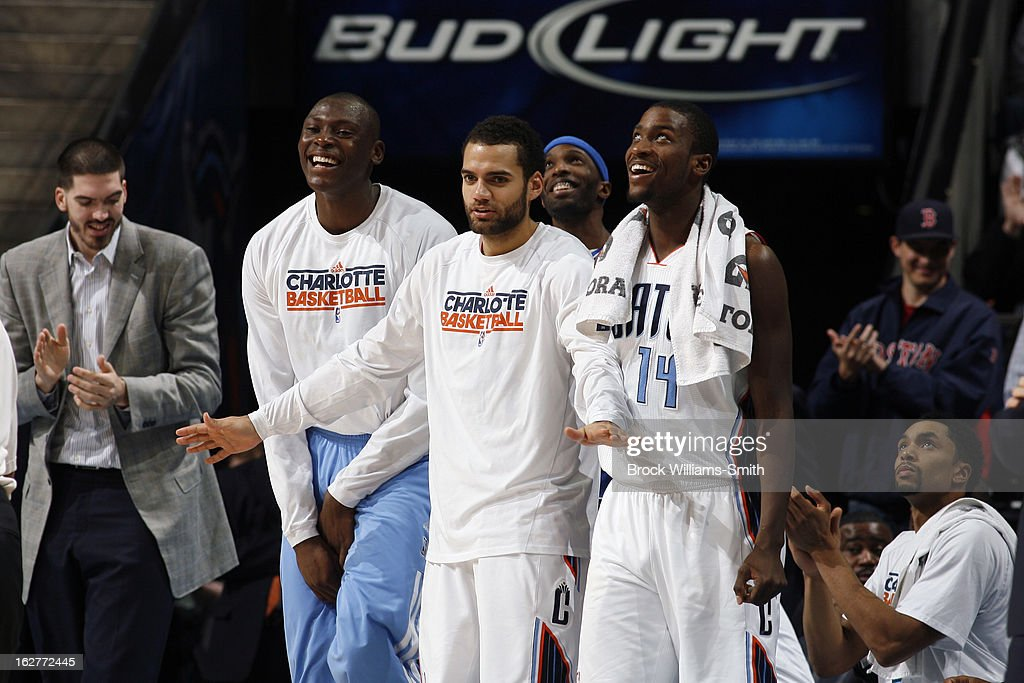 Bismack Biyombo #0, Jeffery Taylor #44 and Michael Kidd-Gilchrist #14 of the Charlotte Bobcats reacts to a play during the game against the Minnesota Timberwolves at the Time Warner Cable Arena on January 26, 2013 in Charlotte, North Carolina.