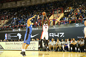 Bismack Biyombo of Team Africa shoots against Nikola Vucevic of Team World during the NBA Africa Game 2015 as part of Basketball Without Boarders on...