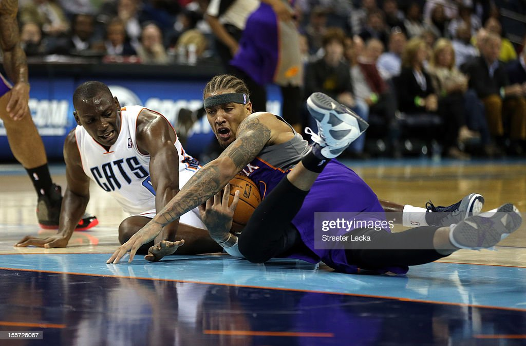 Bismack Biyombo #0 of the Charlotte Bobcats and Michael Beasley #0 of the Phoenix Suns battle for a loose ball during their game at Time Warner Cable Arena on November 7, 2012 in Charlotte, North Carolina.