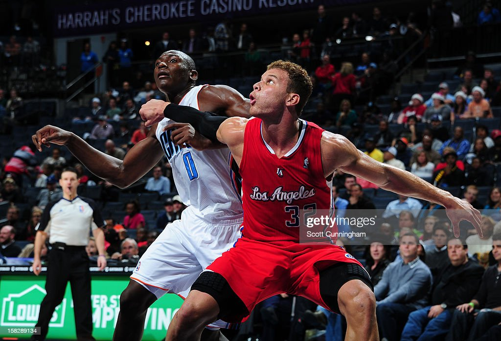 Bismack Biyombo #0 of the Charlotte Bobcats battles for positioning against Blake Griffin #32 of the Los Angeles Clippers at Time Warner Cable Arena on December 12, 2012 in Charlotte, North Carolina.