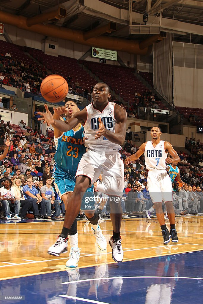 Bismack Biyombo #0 of the Charlotte Bobcats battles for the loose ball against Anthony Davis #23 of the New Orleans Hornets at the North Charleston Coliseum on October 11, 2012 in North Charleston, South Carolina.