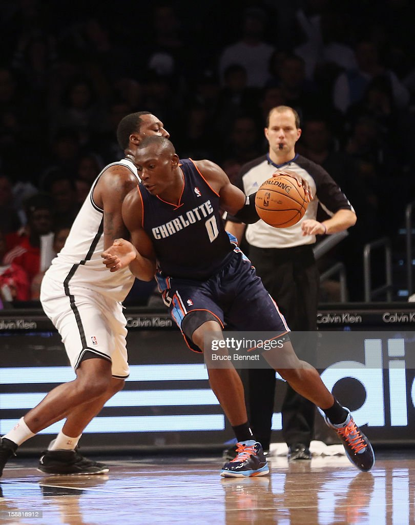 Bismack Biyombo #0 of the Charlotte Bobcats dribbles against the Charlotte Bobcats at the Barclays Center on December 28, 2012 in the Brooklyn borough of New York City.