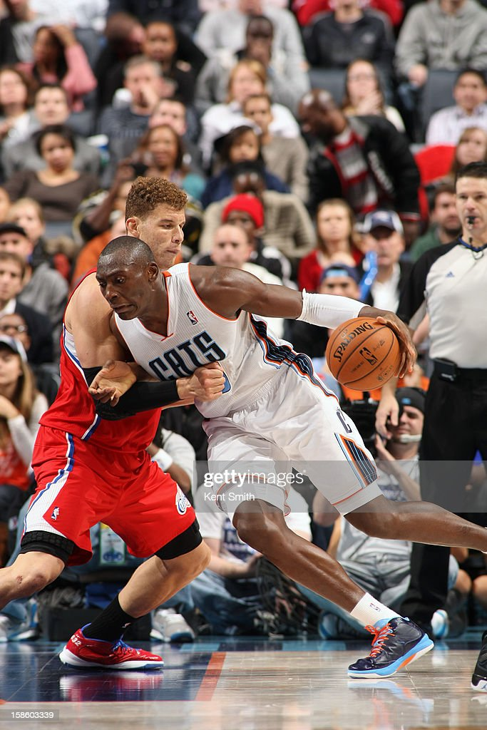 Bismack Biyombo #0 of the Charlotte Bobcats drives to the basket against Blake Griffin #32 of the Los Angeles Clippers at the Time Warner Cable Arena on December 12, 2012 in Charlotte, North Carolina.