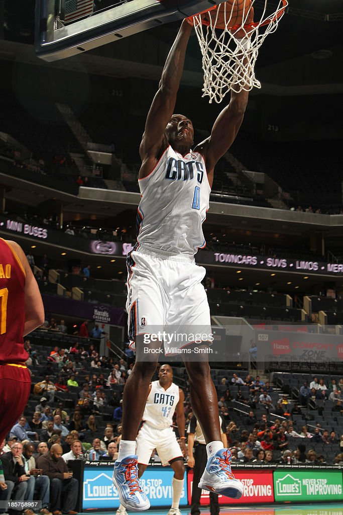 <a gi-track='captionPersonalityLinkClicked' href=/galleries/search?phrase=Bismack+Biyombo&family=editorial&specificpeople=7640443 ng-click='$event.stopPropagation()'>Bismack Biyombo</a> #0 of the Charlotte Bobcats dunks against the Cleveland Cavaliers during the game at the Time Warner Cable Arena on October 24, 2013 in Charlotte, North Carolina.