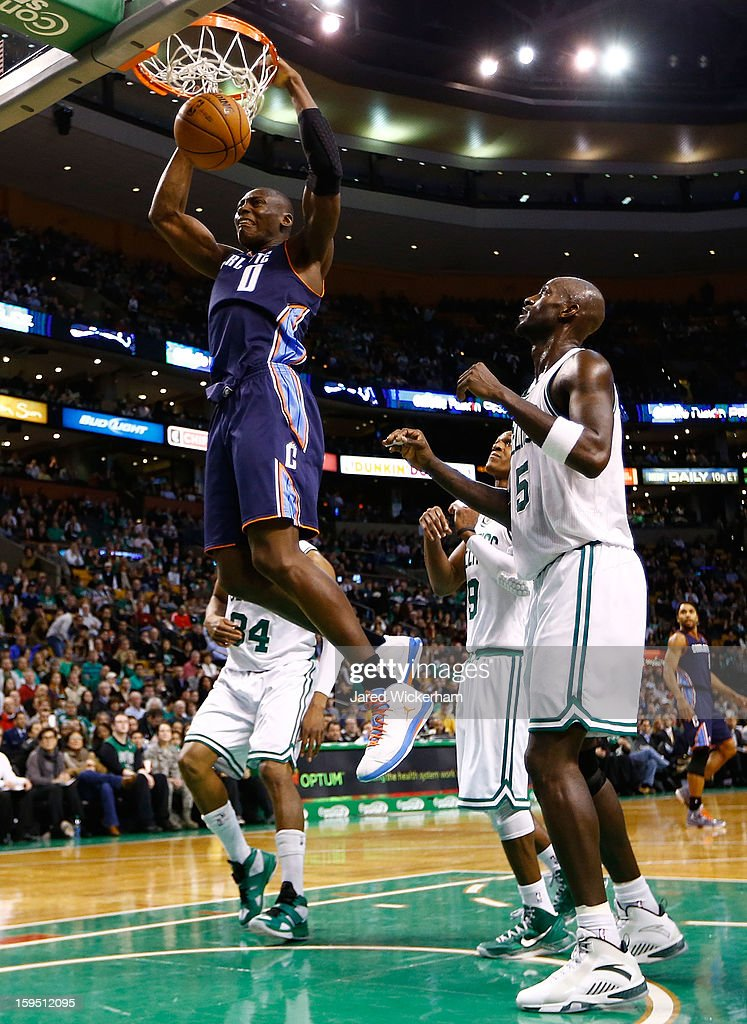 Bismack Biyombo #0 of the Charlotte Bobcats dunks the ball in front of Kevin Garnett #5 of the Boston Celtics during the game on January 14, 2013 at TD Garden in Boston, Massachusetts.
