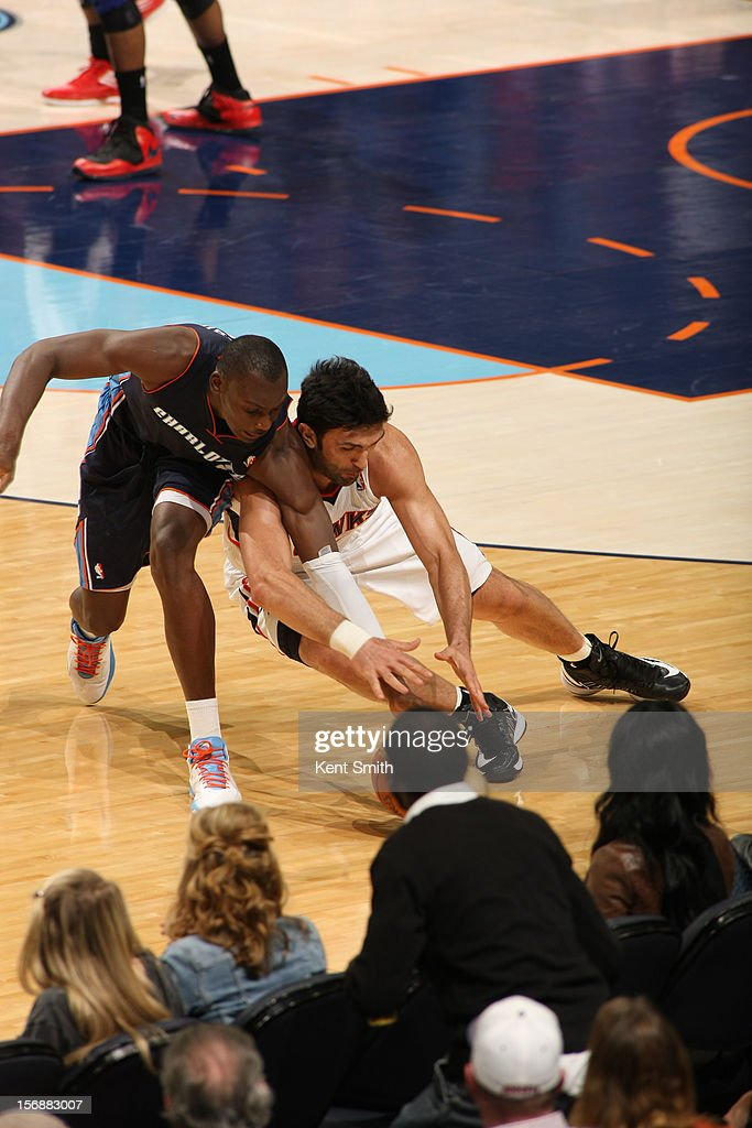 <a gi-track='captionPersonalityLinkClicked' href=/galleries/search?phrase=Bismack+Biyombo&family=editorial&specificpeople=7640443 ng-click='$event.stopPropagation()'>Bismack Biyombo</a> #0 of the Charlotte Bobcats goes for the ball against <a gi-track='captionPersonalityLinkClicked' href=/galleries/search?phrase=Zaza+Pachulia&family=editorial&specificpeople=202939 ng-click='$event.stopPropagation()'>Zaza Pachulia</a> #27 of the Atlanta Hawks at the Time Warner Cable Arena on November 23, 2012 in Charlotte, North Carolina.