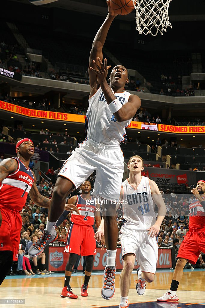 <a gi-track='captionPersonalityLinkClicked' href=/galleries/search?phrase=Bismack+Biyombo&family=editorial&specificpeople=7640443 ng-click='$event.stopPropagation()'>Bismack Biyombo</a> #0 of the Charlotte Bobcats goes up for a shot against the Washington Wizards at the Time Warner Cable Arena on March 31, 2014 in Charlotte, North Carolina.