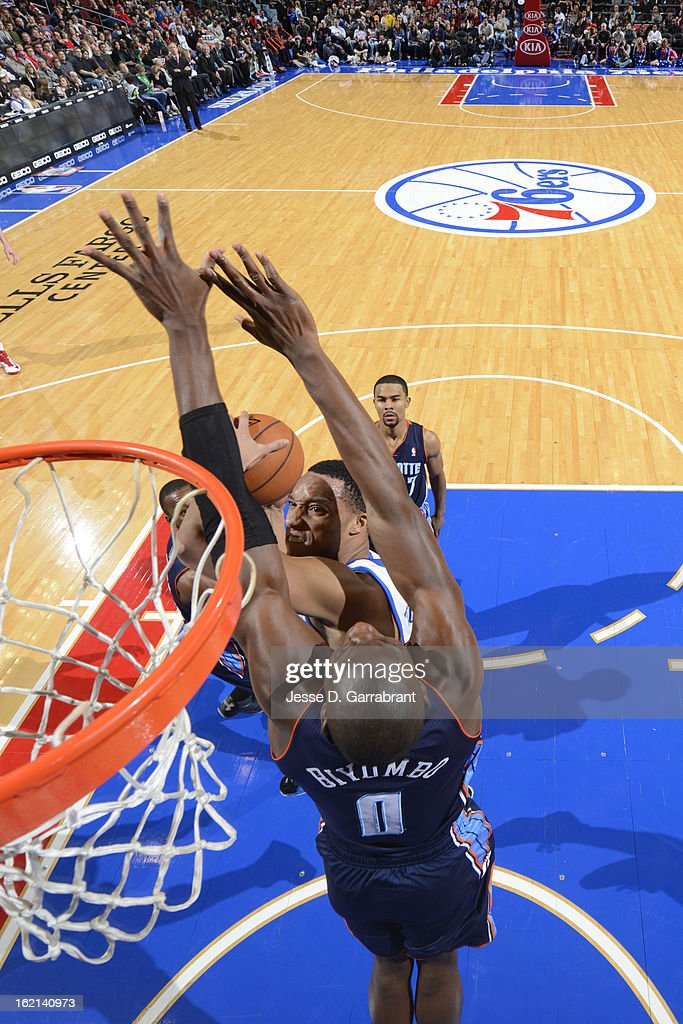 <a gi-track='captionPersonalityLinkClicked' href=/galleries/search?phrase=Bismack+Biyombo&family=editorial&specificpeople=7640443 ng-click='$event.stopPropagation()'>Bismack Biyombo</a> #0 of the Charlotte Bobcats goes up for the block against <a gi-track='captionPersonalityLinkClicked' href=/galleries/search?phrase=Evan+Turner&family=editorial&specificpeople=4665764 ng-click='$event.stopPropagation()'>Evan Turner</a> #12 of the Philadelphia 76ers at the Wells Fargo Center on February 9, 2013 in Philadelphia, Pennsylvania.
