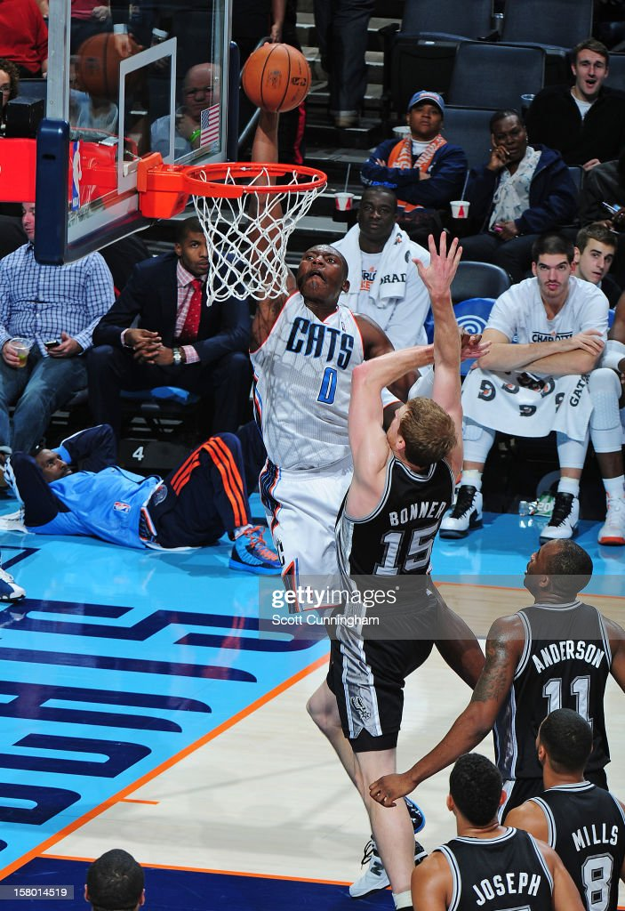 Bismack Biyombo #0 of the Charlotte Bobcats goes up for the dunk against the San Antonio Spurs at Time Warner Cable Arena on December 8, 2012 in Charlotte, North Carolina.
