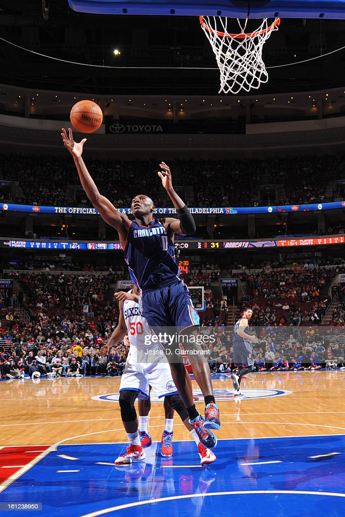 Bismack Biyombo #0 of the Charlotte Bobcats grabs a rebound against the Philadelphia 76ers during the game at the Wells Fargo Center on February 9, 2013 in Philadelphia, Pennsylvania.