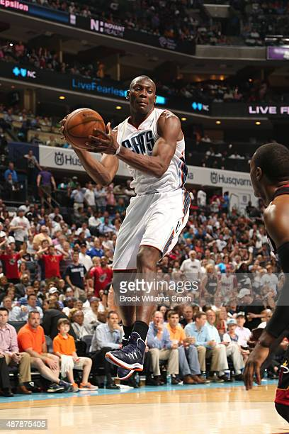 Bismack Biyombo of the Charlotte Bobcats grabs a rebound against the Miami Heat in Game One of the Eastern Conference Quarterfinals of the 2014 NBA...
