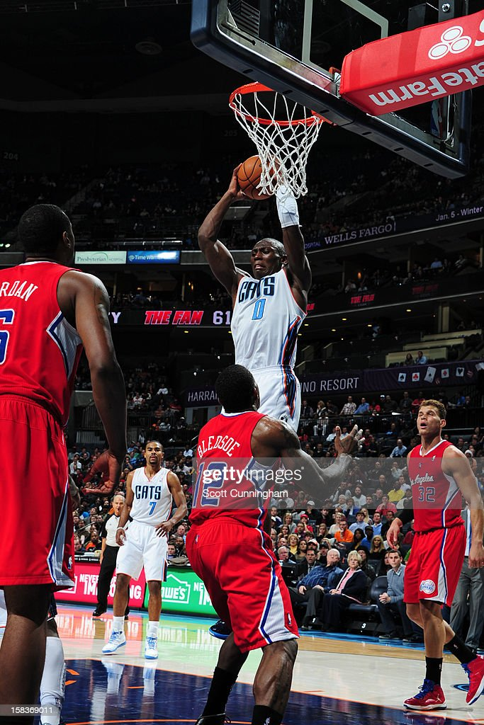 Bismack Biyombo #0 of the Charlotte Bobcats grabs the rebound against the Los Angeles Clippers on December 12, 2012 at Time Warner Cable Arena in Charlotte, North Carolina.