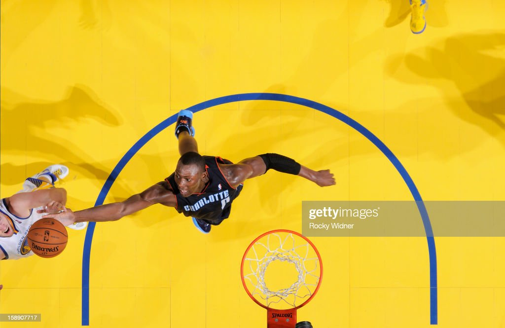 <a gi-track='captionPersonalityLinkClicked' href=/galleries/search?phrase=Bismack+Biyombo&family=editorial&specificpeople=7640443 ng-click='$event.stopPropagation()'>Bismack Biyombo</a> #0 of the Charlotte Bobcats grabs the rebound against David Lee #10 of the Golden State Warriors on December 21, 2012 at Oracle Arena in Oakland, California.