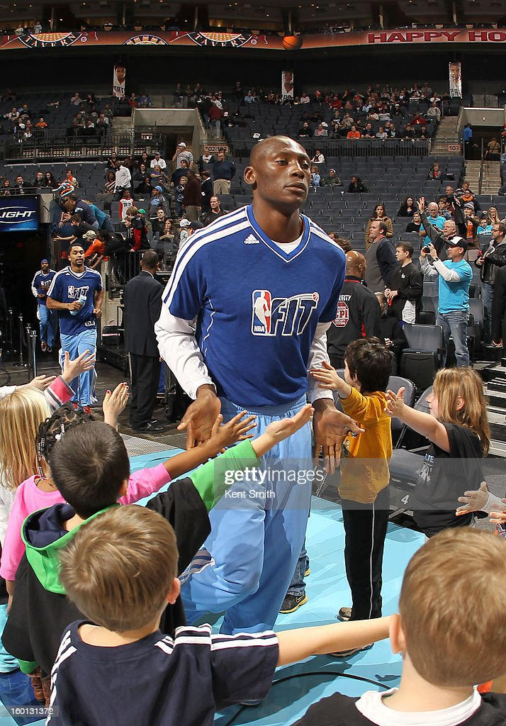 Bismack Biyombo #0 of the Charlotte Bobcats greets young fans while wearing Fit T-shirt before the game against the Minnesota Timberwolves at the Time Warner Cable Arena on January 26, 2013 in Charlotte, North Carolina.