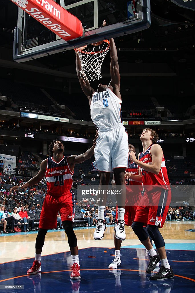 Bismack Biyombo #0 of the Charlotte Bobcats lays the ball up during the game between the Charlotte Bobcats and the Washington Wizards at the Time Warner Cable Arena on October 7, 2012 in Charlotte, North Carolina.