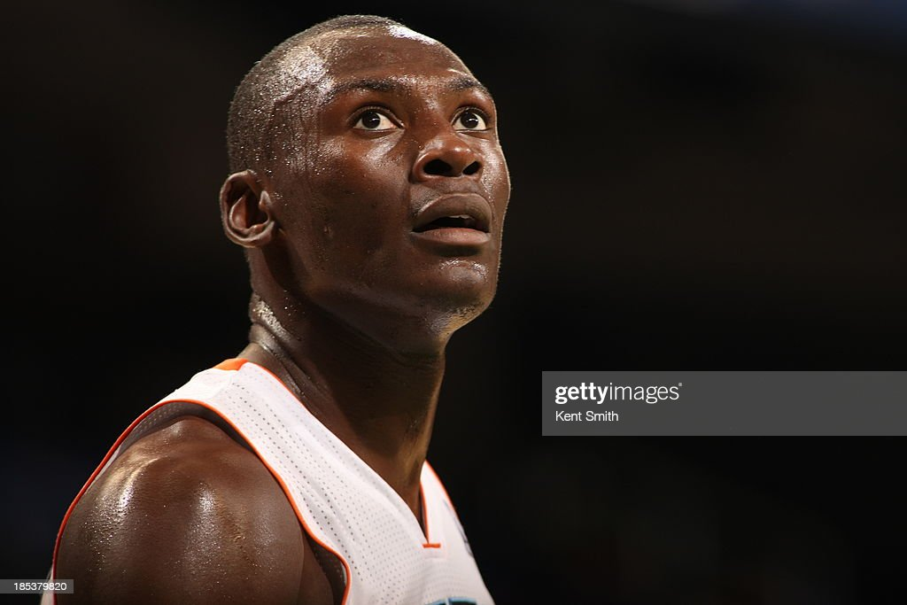 Bismack Biyombo #0 of the Charlotte Bobcats looks on during the game against the Dallas Mavericks at the Greensboro Coliseum on October 19, 2013 in Greensboro, North Carolina.