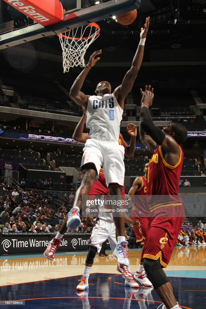 <a gi-track='captionPersonalityLinkClicked' href=/galleries/search?phrase=Bismack+Biyombo&family=editorial&specificpeople=7640443 ng-click='$event.stopPropagation()'>Bismack Biyombo</a> #0 of the Charlotte Bobcats on the rebound against <a gi-track='captionPersonalityLinkClicked' href=/galleries/search?phrase=Dion+Waiters&family=editorial&specificpeople=6902921 ng-click='$event.stopPropagation()'>Dion Waiters</a> #3 of the Cleveland Cavaliers during the game at the Time Warner Cable Arena on October 24, 2013 in Charlotte, North Carolina.