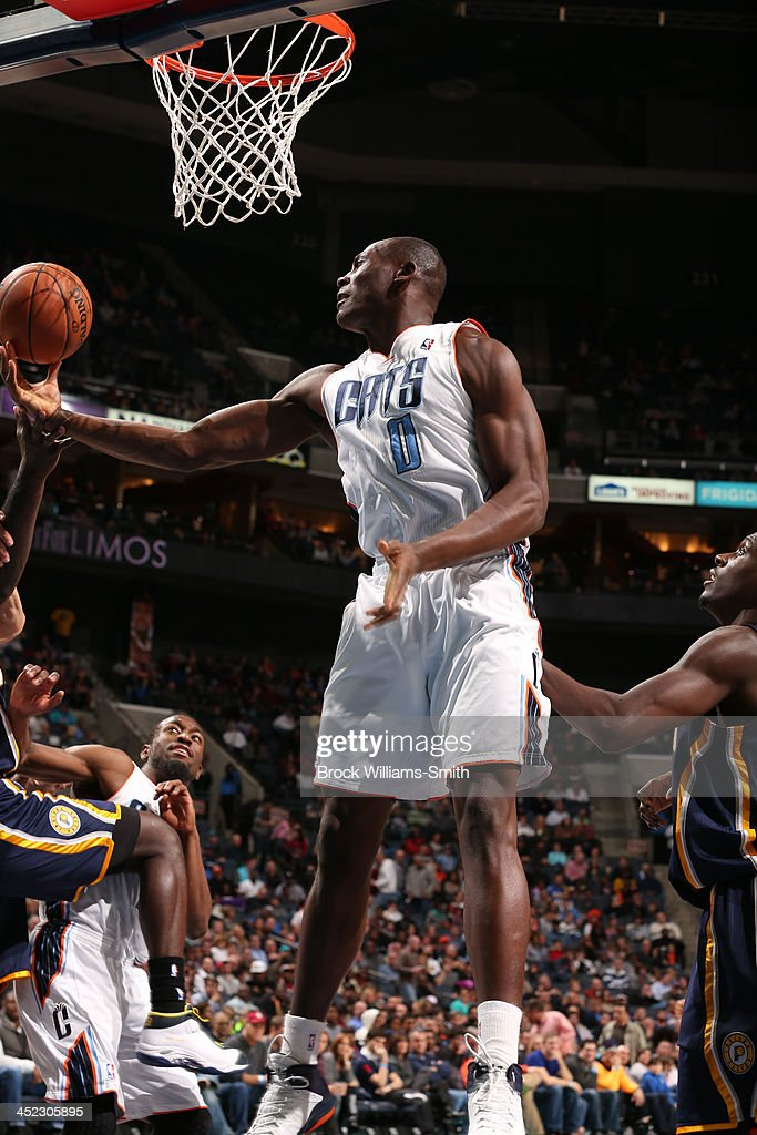 <a gi-track='captionPersonalityLinkClicked' href=/galleries/search?phrase=Bismack+Biyombo&family=editorial&specificpeople=7640443 ng-click='$event.stopPropagation()'>Bismack Biyombo</a> #0 of the Charlotte Bobcats on the rebound against the Indiana Pacers during the game at the Time Warner Cable Arena on November 27, 2013 in Charlotte, North Carolina.