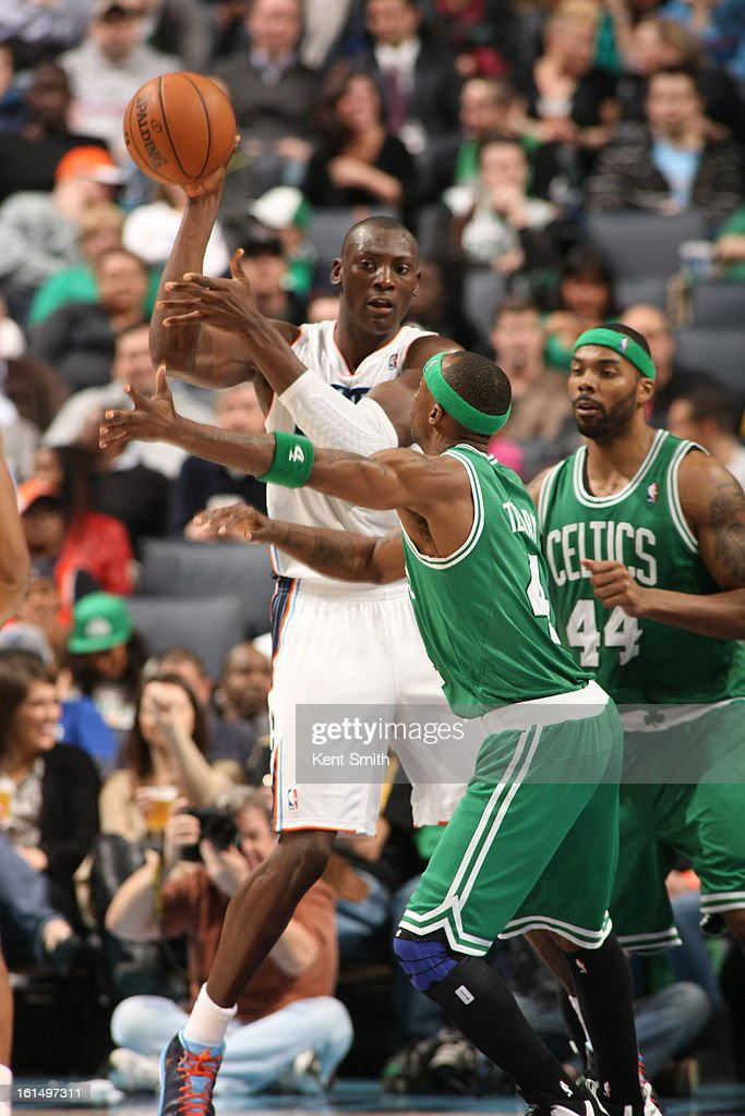Bismack Biyombo #0 of the Charlotte Bobcats passes the ball against Jason Terry #4 of the Boston Celtics at the Time Warner Cable Arena on February 11, 2013 in Charlotte, North Carolina.
