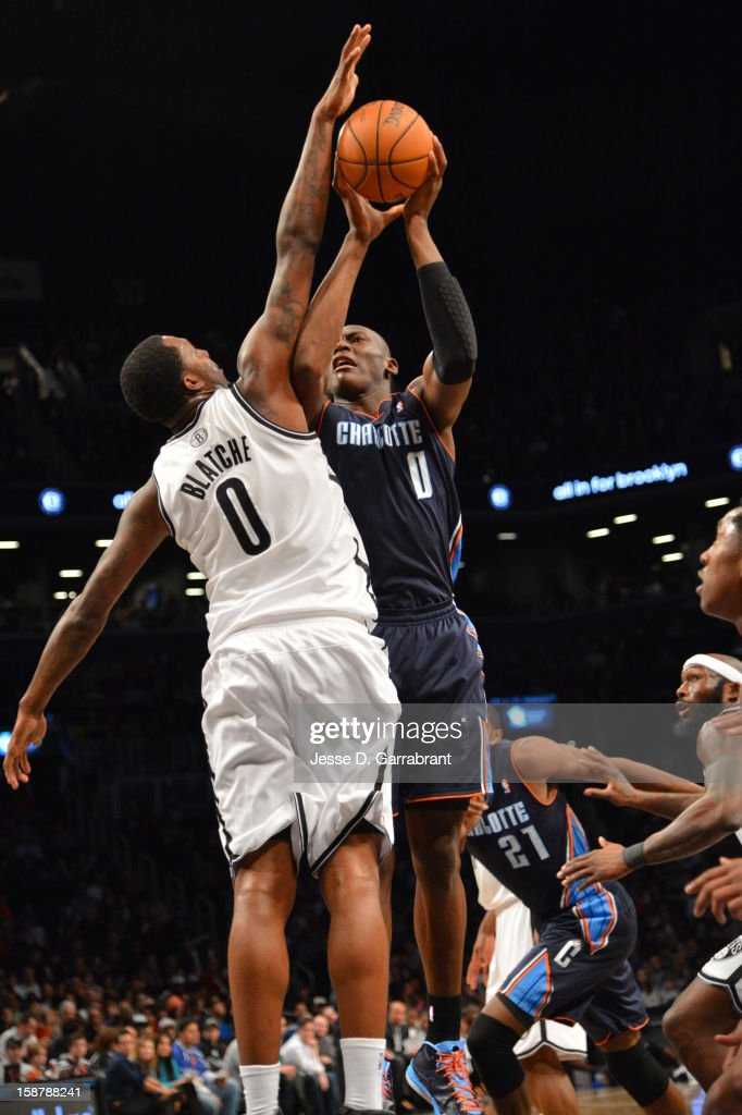 Bismack Biyombo #0 of the Charlotte Bobcats puts up a shot against Andray Blatche #0 of the Brooklyn Nets during the game at the Barclays Center on December 28, 2012 in Brooklyn, New York.