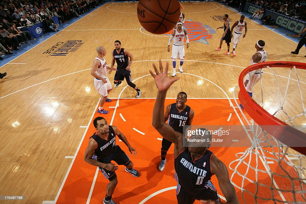 Bismack Biyombo #0 of the Charlotte Bobcats reaches for a rebound against the New York Knicks on March 29, 2013 at Madison Square Garden in New York City.