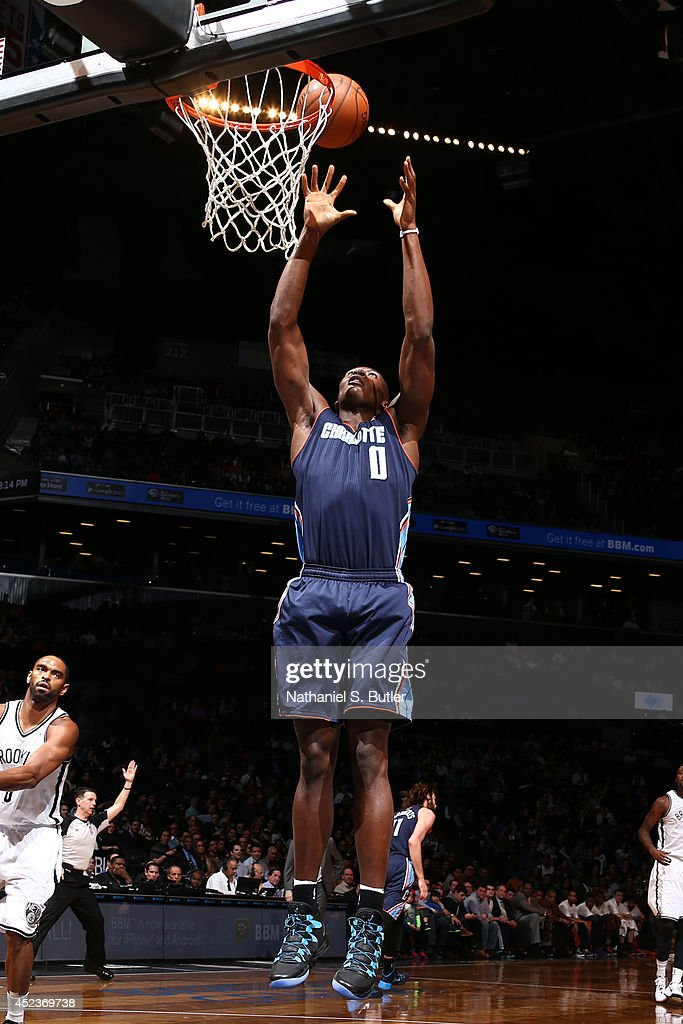 <a gi-track='captionPersonalityLinkClicked' href=/galleries/search?phrase=Bismack+Biyombo&family=editorial&specificpeople=7640443 ng-click='$event.stopPropagation()'>Bismack Biyombo</a> #0 of the Charlotte Bobcats reaches for a rebound against the Brooklyn Nets at the Barclays Center on February 12, 2014 in the Brooklyn borough of New York City.