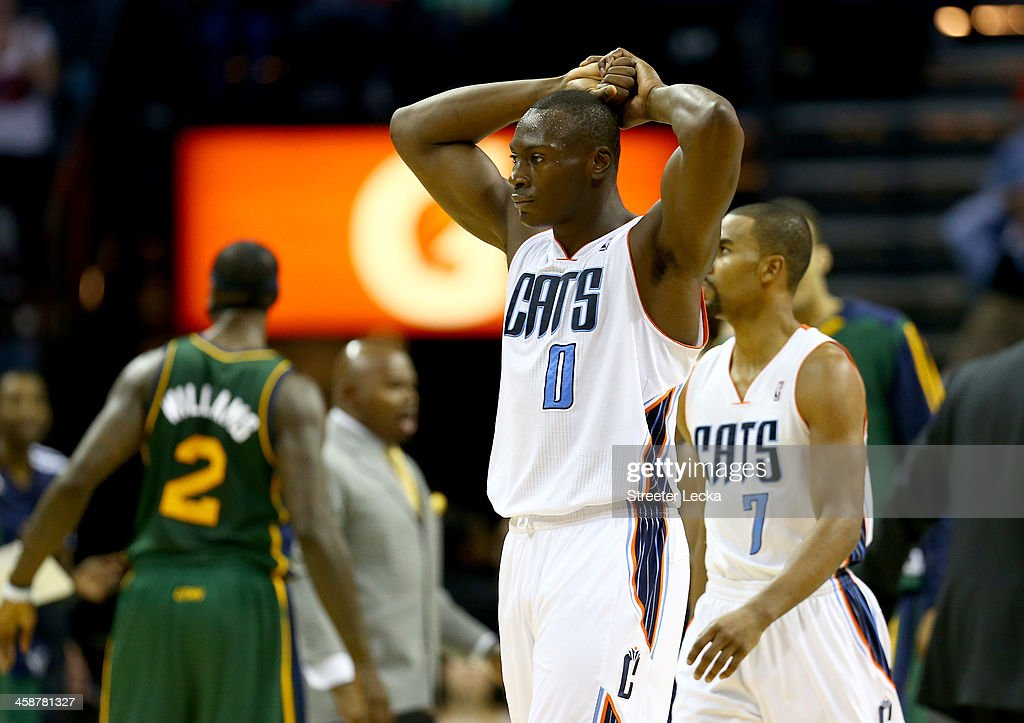 Bismack Biyombo #0 of the Charlotte Bobcats reacts to a call during their game against the Utah Jazz at Time Warner Cable Arena on December 21, 2013 in Charlotte, North Carolina.