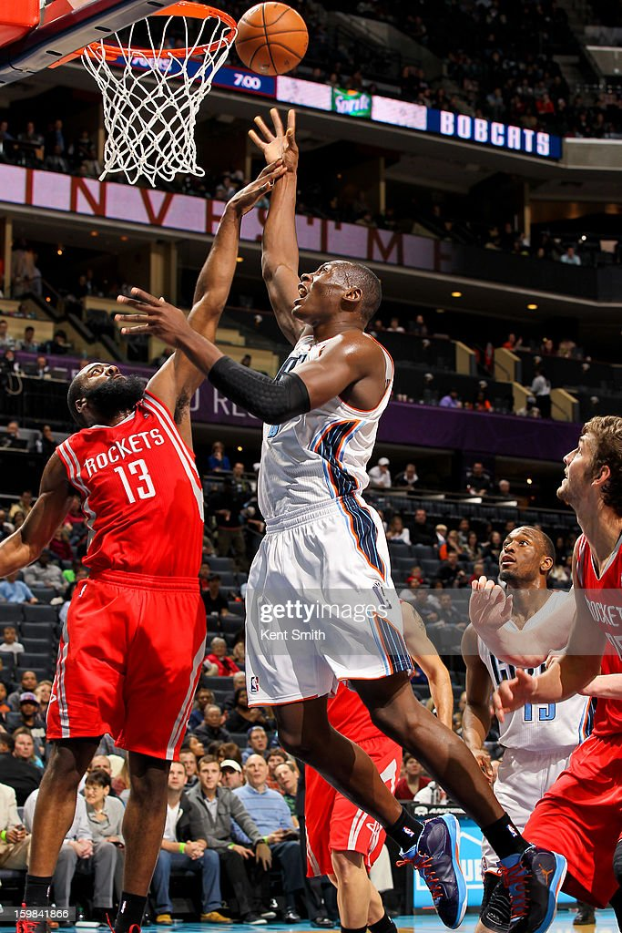 Bismack Biyombo #0 of the Charlotte Bobcats shoots a layup against James Harden #13 of the Houston Rockets at the Time Warner Cable Arena on January 21, 2013 in Charlotte, North Carolina.