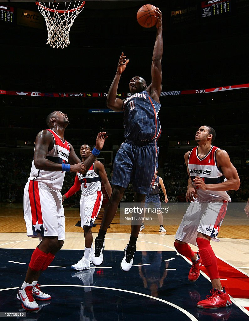 Bismack Biyombo #0 of the Charlotte Bobcats shoots against <a gi-track='captionPersonalityLinkClicked' href=/galleries/search?phrase=Andray+Blatche&family=editorial&specificpeople=4282797 ng-click='$event.stopPropagation()'>Andray Blatche</a> #7 and <a gi-track='captionPersonalityLinkClicked' href=/galleries/search?phrase=JaVale+McGee&family=editorial&specificpeople=4195625 ng-click='$event.stopPropagation()'>JaVale McGee</a> #34 of the Washington Wizards during the game at the Verizon Center on January 25, 2012 in Washington, DC.