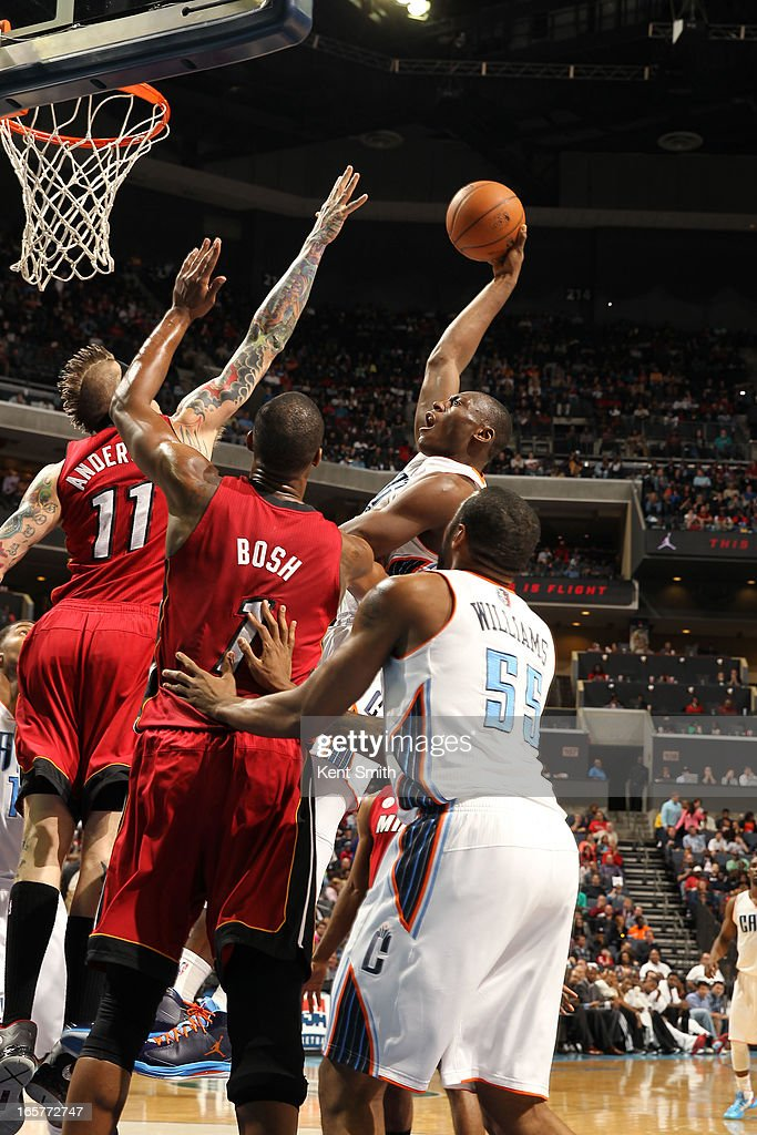 Bismack Biyombo #0 of the Charlotte Bobcats shoots against Chris Andersen #11 of the Miami Heat at the Time Warner Cable Arena on April 5, 2013 in Charlotte, North Carolina.