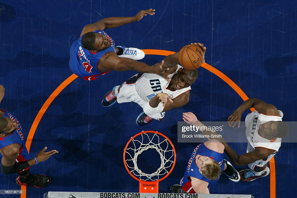 <a gi-track='captionPersonalityLinkClicked' href=/galleries/search?phrase=Bismack+Biyombo&family=editorial&specificpeople=7640443 ng-click='$event.stopPropagation()'>Bismack Biyombo</a> #0 of the Charlotte Bobcats shoots against <a gi-track='captionPersonalityLinkClicked' href=/galleries/search?phrase=Jason+Maxiell&family=editorial&specificpeople=651723 ng-click='$event.stopPropagation()'>Jason Maxiell</a> #54 of the Detroit Pistons at the Time Warner Cable Arena on February 20, 2013 in Charlotte, North Carolina.