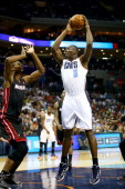 Bismack Biyombo of the Charlotte Bobcats shoots over Chris Bosh of the Miami Heat in Game Four of the Eastern Conference Quarterfinals during the...