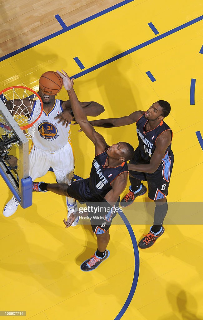 Bismack Biyombo #0 of the Charlotte Bobcats stretches out for the rebound against Festus Ezeli #31 of the Golden State Warriors on December 21, 2012 at Oracle Arena in Oakland, California.