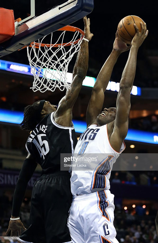 Bismack Biyombo #0 of the Charlotte Bobcats tries to dunk the ball on Gerald Wallace #45 of the Brooklyn Nets during their game at Time Warner Cable Arena on March 6, 2013 in Charlotte, North Carolina.