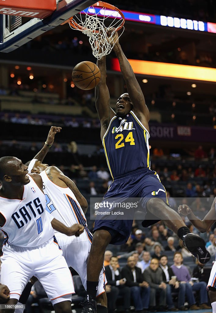 Bismack Biyombo #0 of the Charlotte Bobcats watches as Paul Millsap #24 of the Utah Jazz dunks the ball during their game at Time Warner Cable Arena on January 9, 2013 in Charlotte, North Carolina.