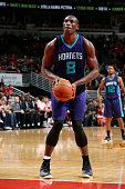 Bismack Biyombo of the Charlotte Hornets attempts a free throw against the Chicago Bulls on October 19 2014 at United Center Chicago Illinois NOTE TO...