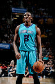 Bismack Biyombo of the Charlotte Hornets attempts a free throw against the Cleveland Cavaliers at The Quicken Loans Arena on January 23 2015 in...