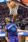 Bismack Biyombo of the Charlotte Hornets dunks during the first half against the Cleveland Cavaliers at Quicken Loans Arena on December 15 2014 in...