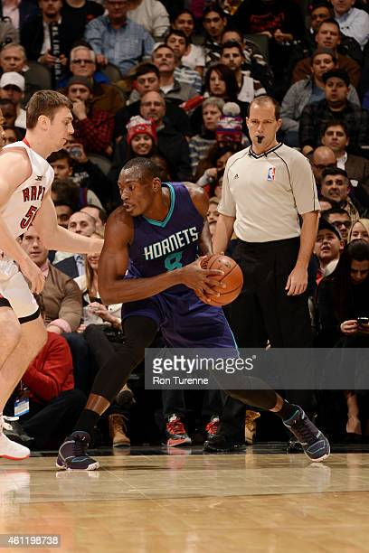 Bismack Biyombo of the Charlotte Hornets handles the ball against the Toronto Raptors on January 8 2015 at the Air Canada Centre in Toronto Ontario...