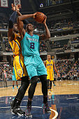 Bismack Biyombo of the Charlotte Hornets handles the ball against the Indiana Pacers on April 3 2015 at Bankers Life Fieldhouse in Indianapolis...